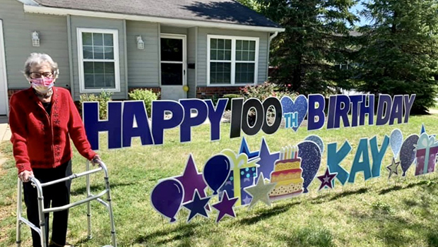 resident with birthday sign outside