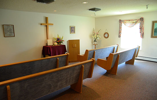 worship room with benches and a podium