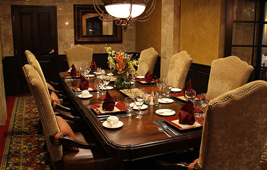 private dining room with a large wooden table