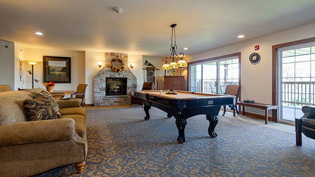 large billiards room with tons of lounge space
