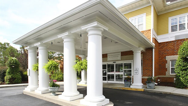 front entrance with an over hang and pillars