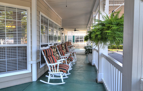 outdoor porch with many rocking chairs
