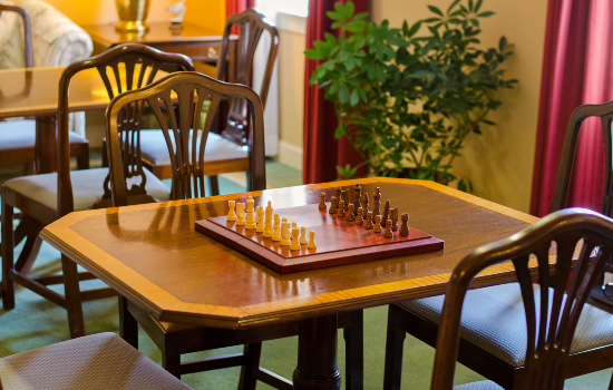 a small table with a chess board set up