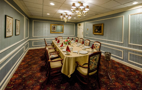 fancy private dining room with a long table