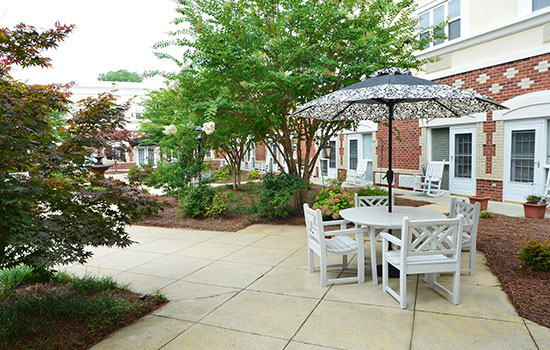 outdoor patio with a table and big umbrella