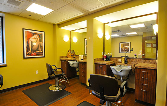beauty salon with multiple hair treatment stations