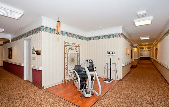 a corner between hall ways with an exercise bike