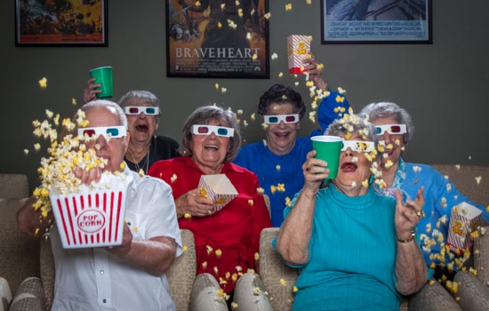 residents having a blast in the theater room