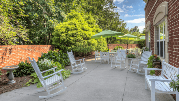 outdoor patio with rocking chairs and umbrellas