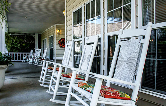 long outdoor patio with rocking chairs