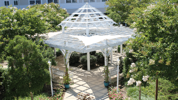 courtyard with a large gazebo providing partial shade