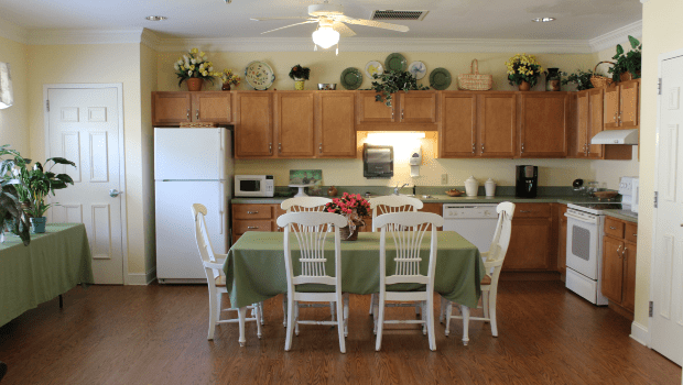 kitchen with a large green dining room table