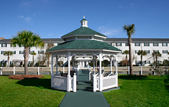 a white gazebo on the lawn outside