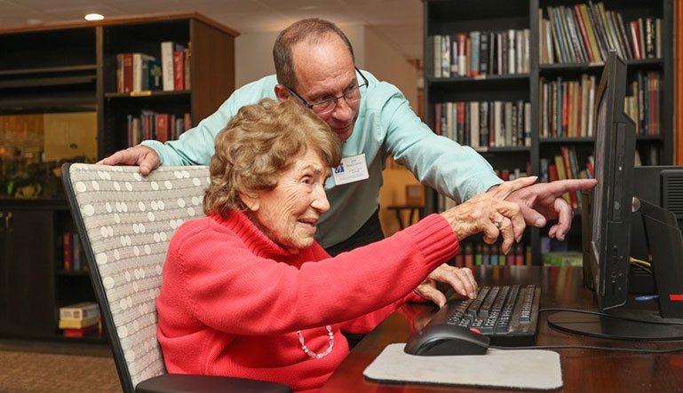 woman and man looking at computer screen
