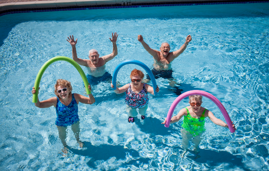 a group of residents having fun in the swimming pool