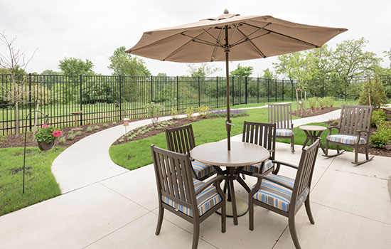 backyard patio with a table and a large umbrella
