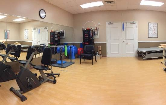rehabilitation room with plenty of rehab equipment