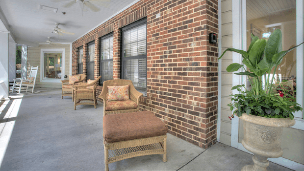 outdoor patio along side the building with nice chairs