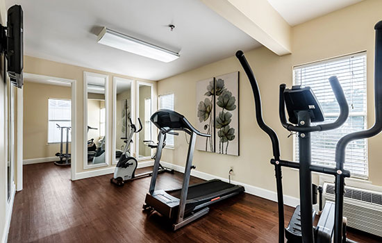 exercise room with elliptical machines