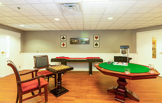 game room with a circular green cards table