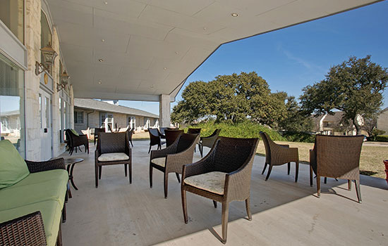 large outdoor patio with a high overhang