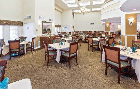 large restaurant style dining room with many tables