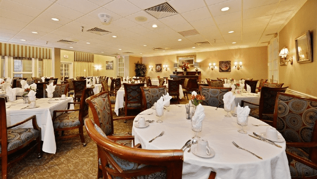 large restaurant style dining room with round tables