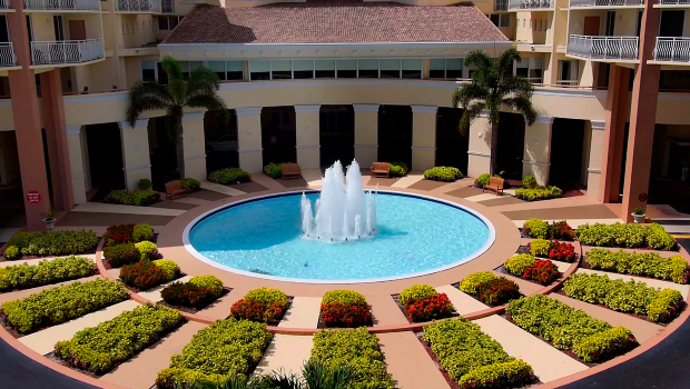 large outdoor water fountain with surrounding gardens