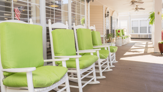 long outdoor patio with many comfortable rocking chairs