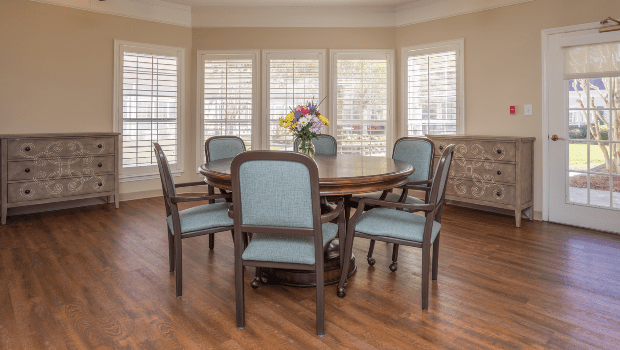 medium sized dining room with nice wooden floors