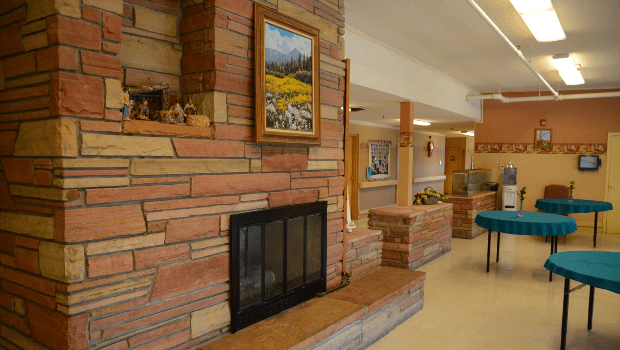 a lounge with a large fire place