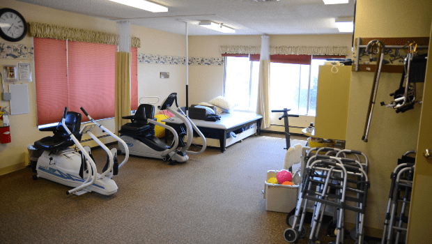 rehabilitation room with lots of workout equipment