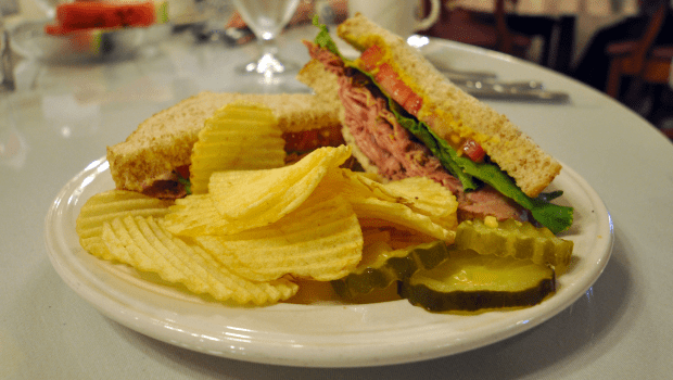 a delicious sandwich with a side of chips
