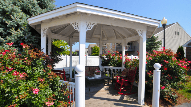 outdoor gazebo surrounded by gardens