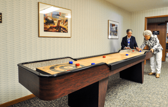 game room with a shuffle board table