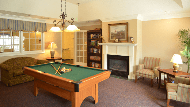 billiards room with a green pool table
