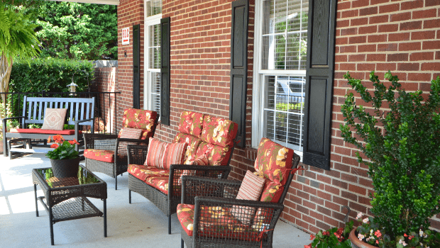 a nice porch with lounge chairs and plants