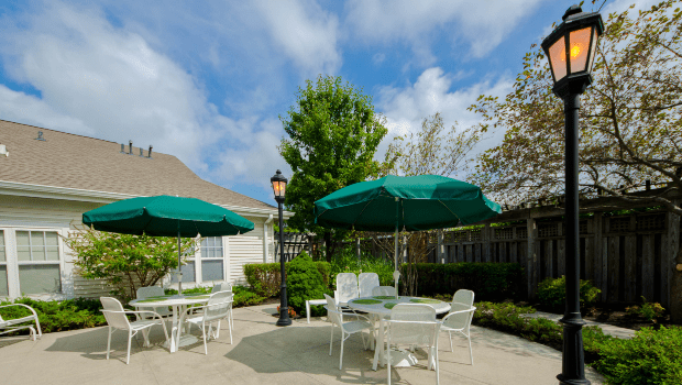 outdoor patio with multiple tables and umbrellas