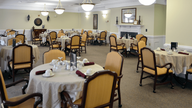 restaurant style dining room with many tables