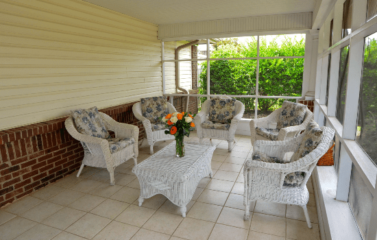 outdoor patio with a coffee table and chairs