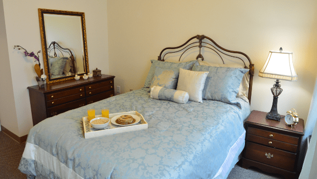 bedroom with a large light blue bed