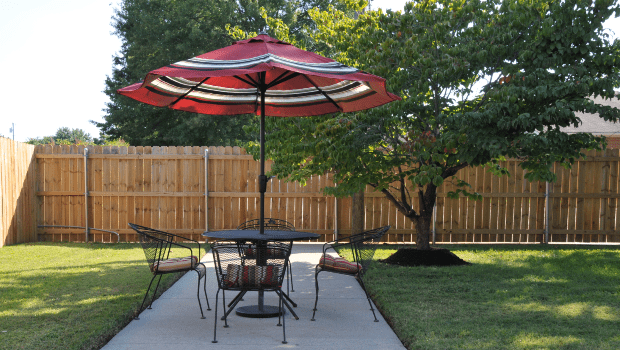 outdoor patio table with a large umbrella