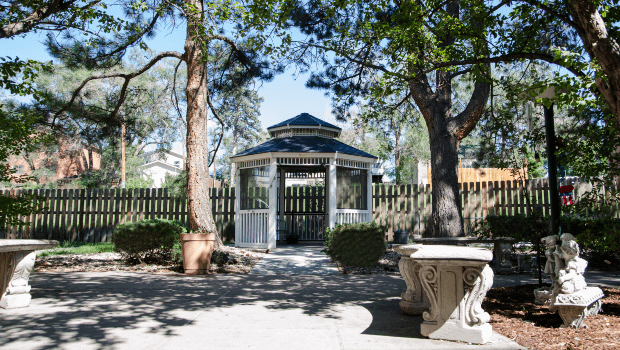 patio with a gazebo and stone benches