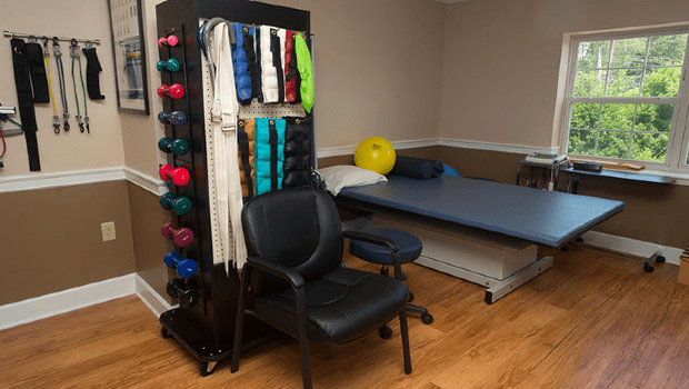 rehabilitation room with plenty of supplies and equipment