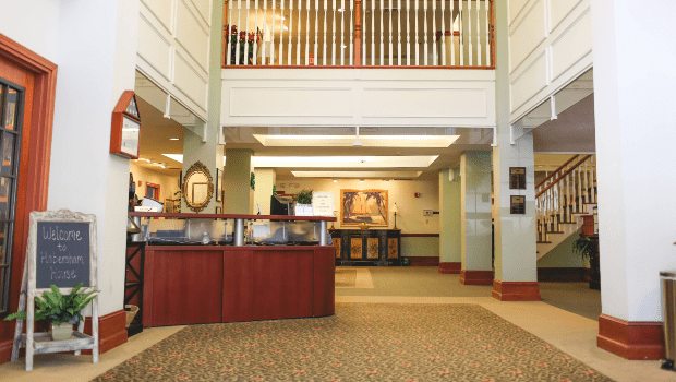front lobby with high ceilings and wide hall ways