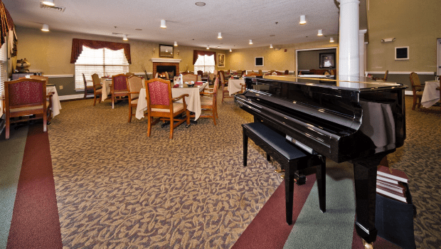 restaurant style dining room with a grand piano
