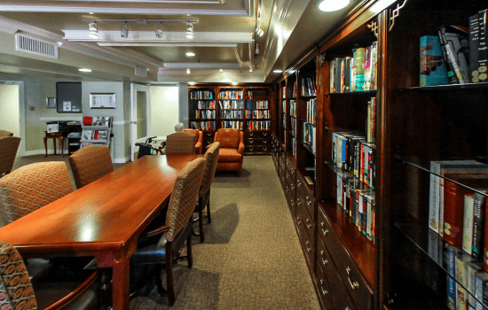 library with many books and long tables