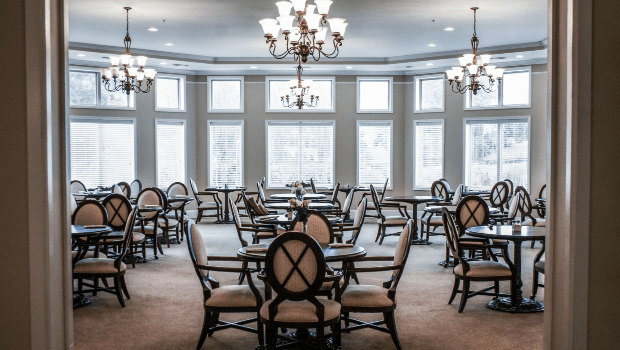 restaurant style dining room with large windows and high ceilings
