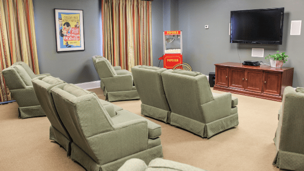 a theater room with comfortable chairs