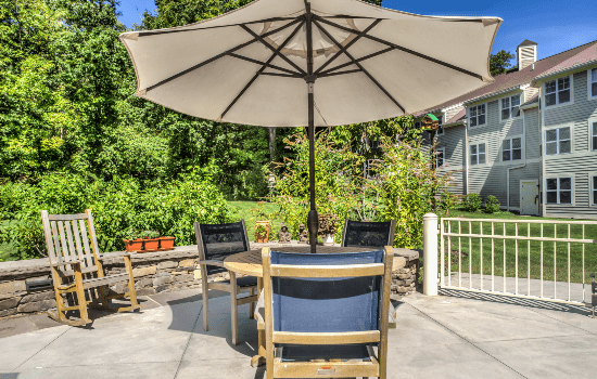 outdoor patio with a table and a big umbrella